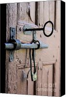 Church Photos Canvas Prints - Old door of wood with its worn lock Canvas Print by Bernard Jaubert