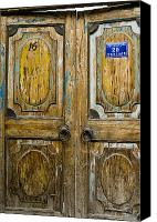Door Handles Canvas Prints - Old Double Wooden Doors Canvas Print by Sam Bloomberg-rissman
