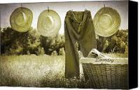 Dry Canvas Prints - Old grunge photo of jeans and straw hats  Canvas Print by Sandra Cunningham