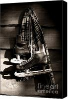 Skates Photo Canvas Prints - Old hockey skates with scarf hanging on a wall Canvas Print by Sandra Cunningham