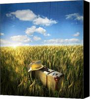 Scenic Digital Art Canvas Prints - Old suitcase with straw hat in field Canvas Print by Sandra Cunningham