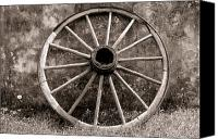 Carriage Canvas Prints - Old Wagon Wheel Canvas Print by Olivier Le Queinec