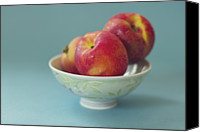 Peach Colored Canvas Prints - Peaches In Bowl On Blue Background Canvas Print by Copyright Anna Nemoy(Xaomena)