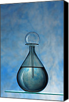 Eau De Cologne Canvas Prints - Perfume bottle on blue background Canvas Print by Chet Chaimangkhalayon