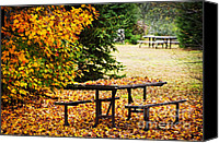 Outdoor Canvas Prints - Picnic table with autumn leaves Canvas Print by Elena Elisseeva