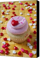 Hearts Photo Canvas Prints - Pink cupcake with candy hearts Canvas Print by Garry Gay