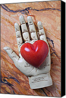 Hearts Photo Canvas Prints - Plam reader hand holding red stone heart Canvas Print by Garry Gay