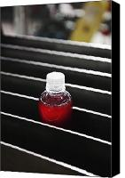 Building Materials Canvas Prints - Plastic Bottle of Red Liquid in a Slot Canvas Print by Jetta Productions, Inc