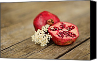 Food And Drink Canvas Prints - Pomegranate And Flowers On Tabletop Canvas Print by Anna Hwatz Photography Find Me On Facebook