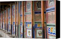Tibetan Canvas Prints - Prayer Wheels In A Row At A Buddhist Canvas Print by David Evans