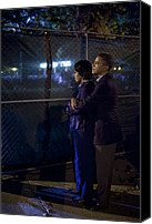 Obama Photo Canvas Prints - President Obama Embraces Michelle Canvas Print by Everett