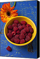 Wooden Bowls Canvas Prints - Raspberries in yellow bowl Canvas Print by Garry Gay