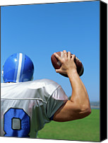Rear Canvas Prints - Rear View Of A Football Player Throwing A Football Canvas Print by Stockbyte