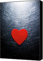Shiny Photo Canvas Prints - Red Felt Heart On Stainless Steel Background. Canvas Print by Ballyscanlon