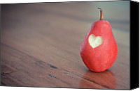 Indoors Canvas Prints - Red Pear With Heart Shape Bit Canvas Print by Danielle Donders - Mothership Photography