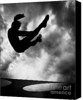 Silhouette Canvas Prints - Returning to Earth Canvas Print by Bob Orsillo