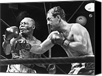 Sweating Canvas Prints - Rocky Marciano Landing A Punch Canvas Print by Everett