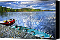 Canada Canvas Prints - Rowboats on lake at dusk Canvas Print by Elena Elisseeva