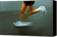 Sports Photo Canvas Prints - Running Canvas Print by Kevin Curtis