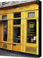 Yellow Building Canvas Prints - Sacha Finkelsztajn Canvas Print by John Rizzuto