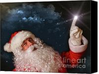 Advertising Canvas Prints - Santa pointing with magical light to the sky Canvas Print by Sandra Cunningham