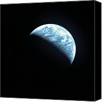 Astronomy Canvas Prints - Satellite View Of A Partially Hidden Earth Canvas Print by Stockbyte
