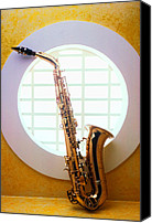 Brass Canvas Prints - Saxophone in round window Canvas Print by Garry Gay