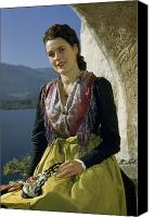 Appearance Canvas Prints - Seated Woman Wears Dirndl Skirt Canvas Print by Volkmar Wentzel
