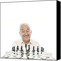 Chess Piece Canvas Prints - Senior Man Playing Chess Canvas Print by