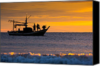 Huahin Canvas Prints - Silhouette fisherman on boat in sunset huahin Canvas Print by Arthit Somsakul