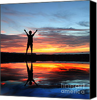 Free Hug Canvas Prints - Silhouette of child on sunset colorful sky. Canvas Print by Suwit Ritjaroon