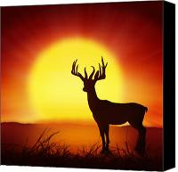 Backdrop Canvas Prints - Silhouette Of Deer With Big Sun Canvas Print by Setsiri Silapasuwanchai