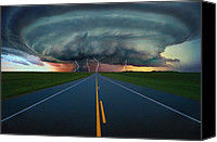 Tornado Canvas Prints - Single Lane Road Leading To Storm Cloud Canvas Print by Don Hammond