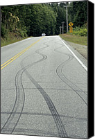 Braking Canvas Prints - Skid Marks On A Road Canvas Print by Alan Sirulnikoff