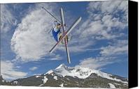 Caucasian Appearance Canvas Prints - Skiing Aerial Maneuvers Off A Jump Canvas Print by Gordon Wiltsie