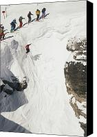 Athletes Canvas Prints - Skilled Skiers Plunge More Than 15 Feet Canvas Print by Raymond Gehman