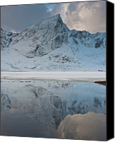 Frozen Canvas Prints - Snow Covered Mountain Reflected In Lake Canvas Print by © Peter Boehi