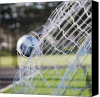 Fitness Ball Canvas Prints - Soccer Ball in Goal Netting Canvas Print by Jetta Productions, Inc