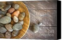 Color Harmony Canvas Prints - Spa rocks in wooden bowl on rustic wood Canvas Print by Sandra Cunningham