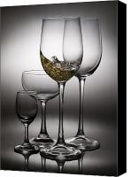 Liquor Canvas Prints - Splashing Wine In Wine Glasses Canvas Print by Setsiri Silapasuwanchai