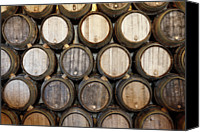No Face Canvas Prints - Stacked Oak Barrels In A Winery Canvas Print by Marc Volk