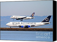 Airways Canvas Prints - Star Alliance Airlines And Frontier Airlines Jet Airplanes At San Francisco International Airport Canvas Print by Wingsdomain Art and Photography