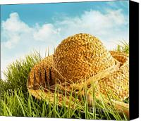 Outdoor Still Life Canvas Prints - Straw hat on grass with blue sky  Canvas Print by Sandra Cunningham