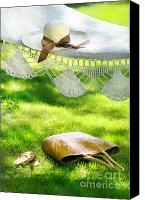 Vacation Digital Art Canvas Prints - Straw hat with brown ribbon laying on hammock Canvas Print by Sandra Cunningham