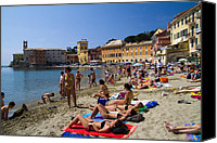 Village Canvas Prints - Sun bathers in Sestri Levante in the Italian Riviera in Liguria Italy Canvas Print by David Smith