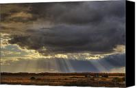 Garbage Canvas Prints - Sun Rays Through Clouds Over Three Old Canvas Print by Dan Jurak