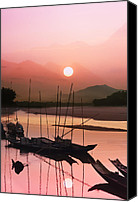 Magic Canvas Prints - sunset at Mae Khong river Canvas Print by Setsiri Silapasuwanchai