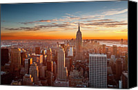 Building Canvas Prints - Sunset Over Manhattan Canvas Print by Inigo Cia