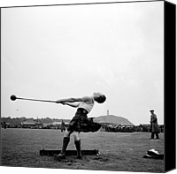 Field Sports Canvas Prints - Swinging Hammer Canvas Print by Chris Ware