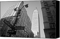 Empire Photo Canvas Prints - The Empire State Building in New York City Canvas Print by Ilker Goksen